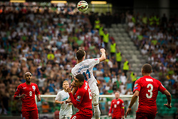 Milivoje Novakovic of Slovenia and Chris Smalling of England during the EURO 2016 Qualifier Group E match between Slovenia and England at SRC Stozice on June 14, 2015 in Ljubljana, Slovenia. Photo by Grega Valancic