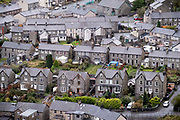 Streets and houses in the industrial revolution-era town of Blaenau Ffestiniog, on 3rd October 2021, in Blaenau Ffestiniog, Gwynedd, Wales. The derelict slate mines around Blaenau Ffestiniog in north Wales were awarded UNESCO World Heritage status in 2021. The industry's heyday was the 1890s when the Welsh slate industry employed approximately 17,000 workers, producing almost 500,000 tonnes of slate a year, around a third of all roofing slate used in the world in the late 19th century. Only 10% of slate was ever of good enough quality and the surrounding mountains now have slate waste and the ruined remains of machinery, workshops and shelters have changed the landscape for square miles.  Photo by Richard Baker / In Pictures via Getty Images