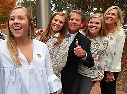 Secretary of State Brian Kemp, Republican candidate for Georgia governor, takes a selfie with his daughters Jarrett, from left, Amy Porter, Lucy, and his wife Marty after they voted at the Winterville Train Depot on Tuesday, Nov. 6, 2018, in Wintervillee, Ga. Photo by Curtis Compton/Atlanta Journal-Constitution/TNS/ABACAPRESS.COM