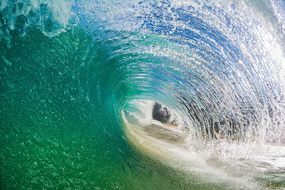Wave breaking off a beach, Na Pali Coast, Kauai, Hawaii, USA