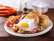 Breakfast - crumpets, sauteed potatoes, fried egg and bacon