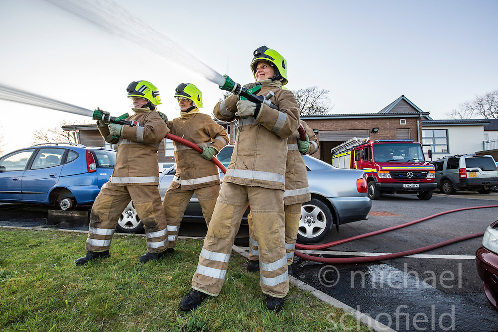 Sarah Jones and Heather Brown on left, and Bonny Mealand and Annabel Lawrence (hidden) in front. News feature on the nearly all-female firefighting crew based at the Fire Shed, Lochaline, on the Morvern Peninsula.