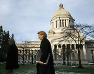 Washington Gov. Chris Gregoire walks from her office with the Capitol building behind. (AP Photo/John Froschauer)
