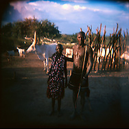 Mundari herdsmen at a cattle camp in Central Equatoria Province. The tribe suffered from inter-tribal conflicts and cattle russling in the northern part of the province, so they moved further south looking for safer grazing land. The area where they settled is contaminated with unexploded ordinance and landmines. Continuing tribal violence is forcing more and more people to be displaced and to arrive in the camp..Kuruki, South Sudan. 12/10/2009..Photo © J.B. Russell