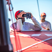 Leg 4, Melbourne to Hong Kong, day 09 on board MAPFRE, Xabi Fernandez looking at other boats with the binoculars. Photo by Ugo Fonolla/Volvo Ocean Race. 09 January, 2018.