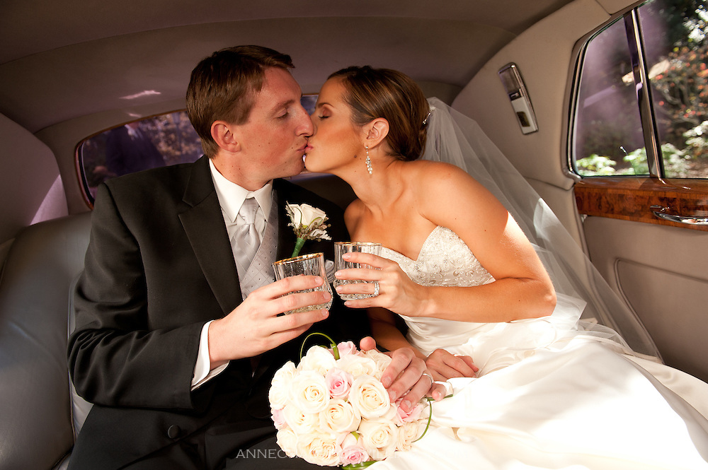 A bride and groom kiss in a Rolls Royce after their Church of the Nativity, Menlo Park, CA.