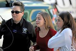 Young women reach the overpass at Coral Springs Drive and the Sawgrass Expressway just south of the campus of Stoneman Douglas High School in Parkland, FL, USA, after a shooting on Wednesday, February 14, 2018. Photo by Amy Beth Bennett/Sun Sentinel/TNS/ABACAPRESS.COM