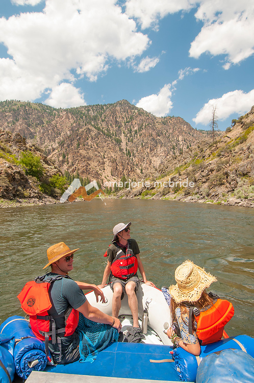 Guests on oar boat enjoying scenic Middle Fork of the Salmon River during a six day rafting trip, Idaho.