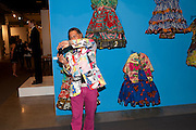FRANCISCO GEORGE WEARING MOSCHINO JACKET IN FRONT OF WORK BY YINKA SHONIBARE, Opening of Miami Art Basel 2011, Miami Beach. 30 November 2011.