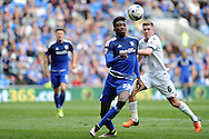 Cardiff City's Sammy Ameobi (c) controls the ball as Bolton's Josh Vela goes to challenge him. Skybet football league championship match, Cardiff city v Bolton Wanderers at the Cardiff city Stadium in Cardiff, South Wales on Saturday 23rd April 2016.<br /> pic by Carl Robertson, Andrew Orchard sports photography.