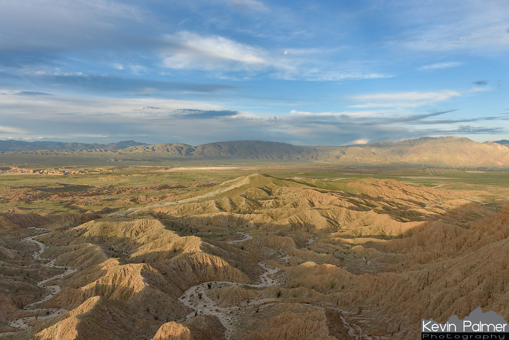 The first light of the day illuminates the Borrego Badlands while the moon sets in the west. This is looking towards Borrego Springs from Font's Point.