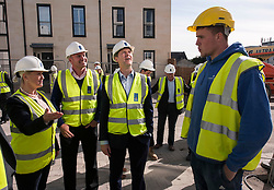 © Licensed to London News Pictures.  28/04/2015. Bath UK.  Deputy Prime Minister Nick Clegg visits the Bath Riverside housing development with Liberal Democrat candidate Steve Bradley and outgoing MP Don Foster.  On the day new GDP figures are published, Nick Clegg's visit highlights the Lib Dem record in Government of stimulating sustainable economic development that delivered jobs and apprenticeships. Photo credit : Simon Chapman/LNP