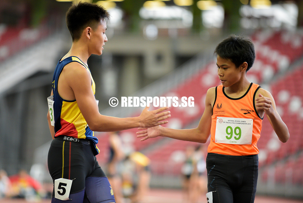 Mark Lee (#143, on the left) of Anglo-Chinese School (Independent) celebrates with Jamie El-Redha Ang Bin Norhisham of (#99) Singapore Sports School after the C Division boys' 100m final. (Photo © Eileen Chew/Red Sports)