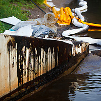 Oil dripping down embankment after manual cleanup, Liberty Park, Salt Lake City