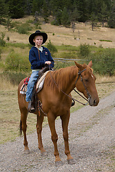 United States, Montana, Livingston, boy on horse at dude ranch  MR