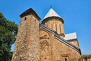 Pictures & images of the Church of the Assumption built in 1689. and a a tower with a stepped pyramidal roof of Svanetian type,  Ananuri castle complex & Georgian Orthodox churches, 17th century, Georgia (country).<br /> <br /> Ananuri castle is situated next to the Military Road overlooking the Aragvi River in Georgia, about 45 miles (72 kilometres) from Tbilisi. It was the castle of the eristavis (Dukes) of Aragvi from the 13th century and was the scene of numerous battles. In 2007 Ananuri castle was enscribed on the   UNESCO World Heritage Site tentative list. .<br /> <br /> Visit our MEDIEVAL PHOTO COLLECTIONS for more   photos  to download or buy as prints https://funkystock.photoshelter.com/gallery-collection/Medieval-Middle-Ages-Historic-Places-Arcaeological-Sites-Pictures-Images-of/C0000B5ZA54_WD0s<br /> <br /> Visit our REPUBLIC of GEORGIA HISTORIC PLACES PHOTO COLLECTIONS for more photos to browse, download or buy as wall art prints https://funkystock.photoshelter.com/gallery-collection/Pictures-Images-of-Georgia-Country-Historic-Landmark-Places-Museum-Antiquities/C0000c1oD9eVkh9c