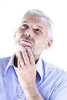 caucasian senior man portrait thoughtful isolated studio on white background