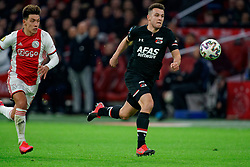 Lisandro Martínez #21 of Ajax and Oussama Idrissi #11 of AZ Alkmaar in action during the Dutch Eredivisie match round 25 between Ajax Amsterdam and AZ Alkmaar at the Johan Cruijff Arena on March 01, 2020 in Amsterdam, Netherlands