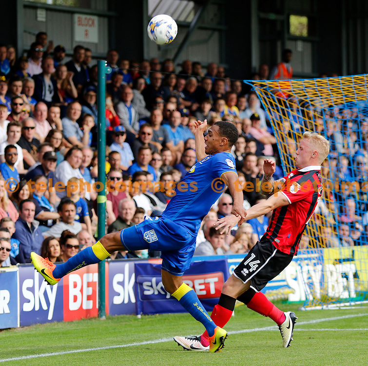 AFC Wimbledon's Darius Charles hooks the ball back into play during the Sky Bet League 1 match between AFC Wimbledon and Shrewsbury Town at the Cherry Red Records Stadium in Kingston. September 24, 2016.<br /> Carlton Myrie / Telephoto Images<br /> +44 7967 642437