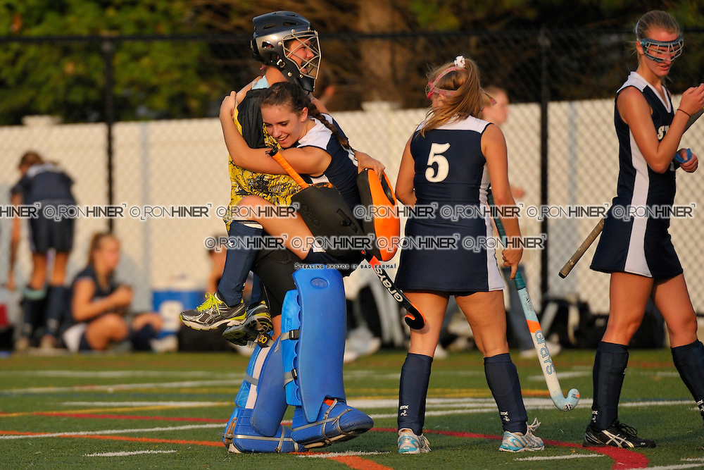Staples High School Field Hockey..Staples defeats Stamford West Hill 6-1..Chris Lueb (GK)(SR).Jackie Lawrence.Claire Carroll