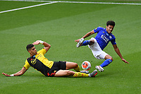 Football - 2019 / 2020 Premier League - Watford vs. Leicester City<br /> <br /> Leicester City's James Justin is fouled by Watford's Adam Masina, at Vicarage Road.<br /> <br /> COLORSPORT/ASHLEY WESTERN