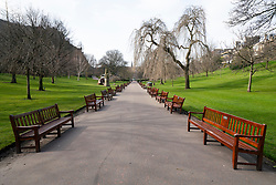 Edinburgh, Scotland, UK. 24 March, 2020.  West Princes Street Gardens open but deserted.  All shops and restaurants are closed with very few people venturing outside following the Government imposed lockdown today. Iain Masterton/Alamy Live News