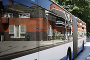 Het Schip Amsterdam school architecture by Michel de Klerk reflecting in a bus window