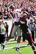 Oct 27, 2012; Little Rock, AR, USA; Arkansas Razorback cornerback Will Hines (9) interferes with a pass intended for Ole Miss Rebels wide receiver Donte Moncrief (12) during the first half at War Memorial Stadium.  Mandatory Credit: Beth Hall-US PRESSWIRE