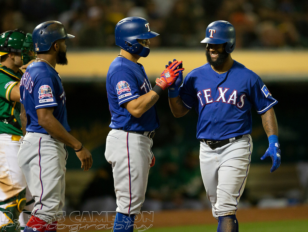 Jul 25, 2019; Oakland, CA, USA; Texas Rangers left fielder Danny Santana (38) is greeted by his teammates after hitting a grand slam against the Oakland Athletics during the sixth inning of a baseball game at Oakland Coliseum. Mandatory Credit: D. Ross Cameron-USA TODAY Sports