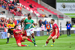 Iliesa Ratuva of Benetton Treviso offloads the ball despite the tackle of Dan Jones of Scarlets<br /> <br /> Photographer Craig Thomas/Replay Images<br /> <br /> Guinness PRO14 Round 3 - Scarlets v Benetton Treviso - Saturday 15th September 2018 - Parc Y Scarlets - Llanelli<br /> <br /> World Copyright © Replay Images . All rights reserved. info@replayimages.co.uk - http://replayimages.co.uk