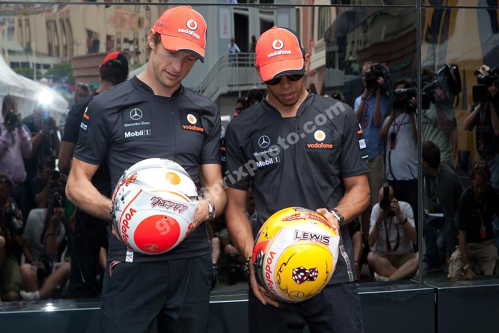 Jenson Button Lewis Hamilton both (MacLaren-Mercedes) with first name in Steinmetz diamonds on helmet before the 2011 Monaco Grand Prix. Photo Grand Prix Photo