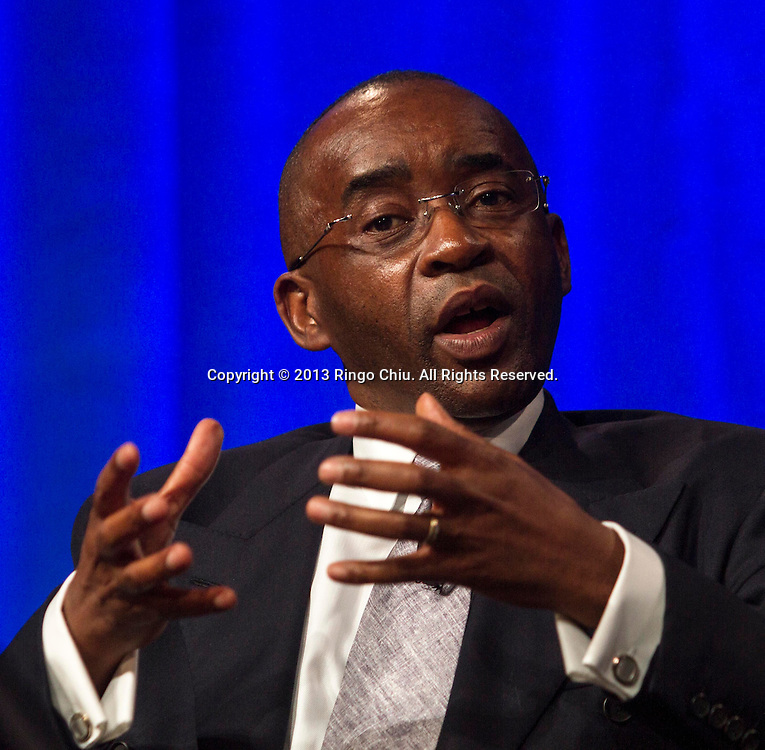 """Strive Masiyiwa, Chairman and founder of Econet Wireless, speaks in a panel """"Investing in African Prosperity"""" during Milken Institute Global Conference on Wednesday, May 1, 2013 in Beverly Hills, California.  (Photo by Ringo Chiu/PHOTOFORMULA.com)."""