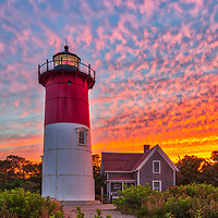 Cape Cod Nauset Beach Lighthouse is one of the most iconic Cape Cod lighthouses and famous for its use on the logo of the Cape Cod Chips. It is located in the town of Eastham, Massachusetts next to Nauset Beach and not far from Coastguard Beach along the Cape Cod National Seashore. Visiting Cape Cod and the Islands is always a lot of fun. I finally was able to head out to photograph Nauset Lighthouse at sunset when the sky exploded into beautiful colors. <br /> New England Cape Cod lighthouse fine art photography images are available as museum quality photography prints, canvas prints, acrylic prints or metal prints. Fine art prints may be framed and matted to the individual liking and decorating needs:<br /> <br /> https://juergen-roth.pixels.com/featured/cape-cod-nauset-beach-lighthouse-juergen-roth.html<br /> <br /> All New England photos are available for photography image licensing at www.RothGalleries.com. Please contact Juergen with any questions or request. <br /> <br /> Good light and happy photo making!<br /> <br /> My best,<br /> <br /> Juergen