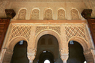 """Moorish architecture of an inner courtyard  of the Palacios Nazaries,  Alhambra. Granada, Andalusia, Spain. . The Alhambra is a palace and fortress complex located in Granada, Andalusia, Spain. It was originally constructed as a small fortress in 889 CE on the remains of ancient Roman fortifications. The Alhambra was renovated and rebuilt in the mid-13th century by the Arab Nasrid emir Mohammed ben Al-Ahmar of the Emirate of Granada, who built its current Alhambra palace and walls. The Alhambra was converted into a royal palace in 1333 by Yusuf I, Sultan of Granada. The decoration of The Alhambra consists for the upper part of the walls, as a rule, of Arabic inscriptions—mostly poems by Ibn Zamrak and others praising the palace—that are manipulated into geometrical patterns with vegetal background set onto an arabesque setting (""""Ataurique""""). Much of this ornament is carved stucco (plaster) rather than stone. Tile mosaics (""""alicatado"""") of The Alhambra, with complicated mathematical patterns (""""tracería"""", most precisely """"lacería""""), are largely used as panelling for the lower part. .<br /> <br /> Visit our SPAIN HISTORIC PLACXES PHOTO COLLECTIONS for more photos to download or buy as wall art prints https://funkystock.photoshelter.com/gallery-collection/Pictures-Images-of-Spain-Spanish-Historical-Archaeology-Sites-Museum-Antiquities/C0000EUVhLC3Nbgw <br /> .<br /> Visit our ISLAMIC HISTORICAL PLACES PHOTO COLLECTIONS for more photos to download or buy as wall art prints https://funkystock.photoshelter.com/gallery-collection/Islam-Islamic-Historic-Places-Architecture-Pictures-Images-of/C0000n7SGOHt9XWI"""
