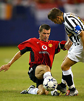 Photo Aidan Ellis.<br />Manchester United v juventus (Champions World Match at New York Giants Stadium East Rutherford).31/07/03.<br />United's Roy Keane tackles Juve's Alessandro Del Pierro