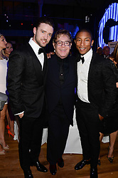 Left to right, JUSTIN TIMBERLAKE, SIR ELTON JOHN and PHARRELL WILLIAMS at the GQ Men of The Year Awards 2013 in association with Hugo Boss held at the Royal Opera House, London on 3rd September 2013.