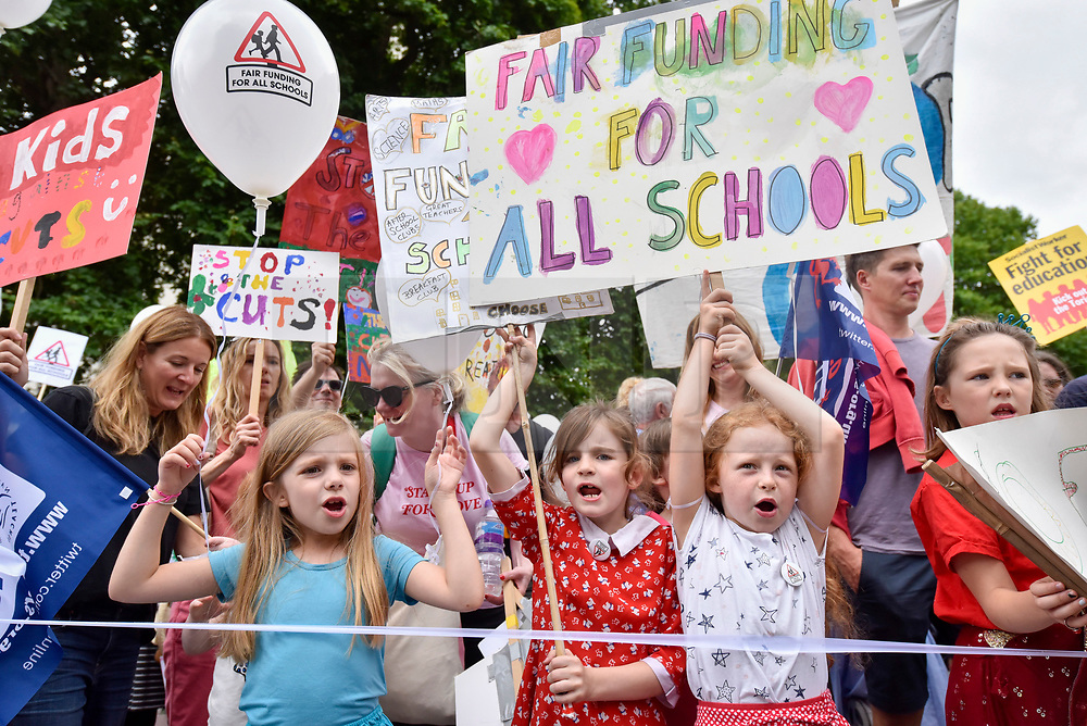 """© Licensed to London News Pictures. 16/07/2017. London, UK. Parents, pupils and teachers gather for an event called """"Carnival Against The Cuts"""" marching to Parliament Square.  The demonstration, organised by Fair Funding For Schools, a parent led campaign, calls for the government to increase funding for schools.   Photo credit : Stephen Chung/LNP"""