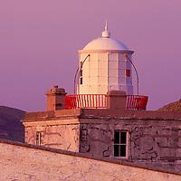 Closeup Valentia Island Lighthouse Tower during colourful sunset, County Kerry, Ireland irish landscapes / vl113