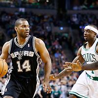 21 November 2012: San Antonio Spurs point guard Gary Neal (14) drives past Boston Celtics shooting guard Jason Terry (4) and Boston Celtics power forward Kevin Garnett (5) during the San Antonio Spurs 112-100 victory over the Boston Celtics at the TD Garden, Boston, Massachusetts, USA.