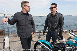 Small City Cycles Todd Asin with Dice Magazine's Dean Micetich at the docks with all of the invited builder's bikes for the Mooneyes show. Yokohama, Japan. Saturday December 2, 2017. Photography ©2017 Michael Lichter.
