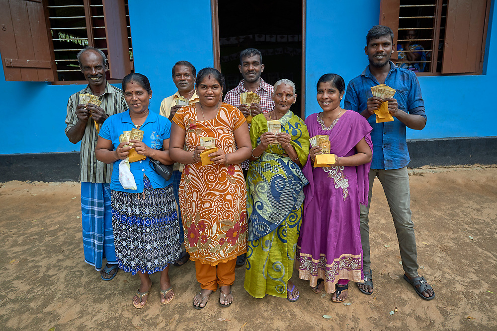 Recipients of microcredit loans from a church group pose in Karadianaru, Sri Lanka. They were displaced during Sri Lanka's bloody civil war, but are now back home and struggling to rebuild the local economy.
