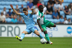 Coventry City's Tom Bayliss (left) and Plymouth Argyle's Yann Songo'o battle for the ball