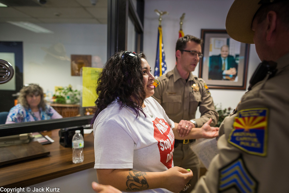 17 OCTOBER 2013 - PHOENIX, AZ:  VANESSA VARELA is arrested by Arizona Capitol Police in the office of the Attorney General. About 100 people came to the office of Arizona Attorney General Tom Horne to protest the decision by Horne to sue community colleges in Maricopa County that charge DREAM Act students who are residents of Arizona out of state tuition rather than in state resident tuition. Nearly 10 people were arrested in a planned civil disobedience during the protest.     PHOTO BY JACK KURTZ