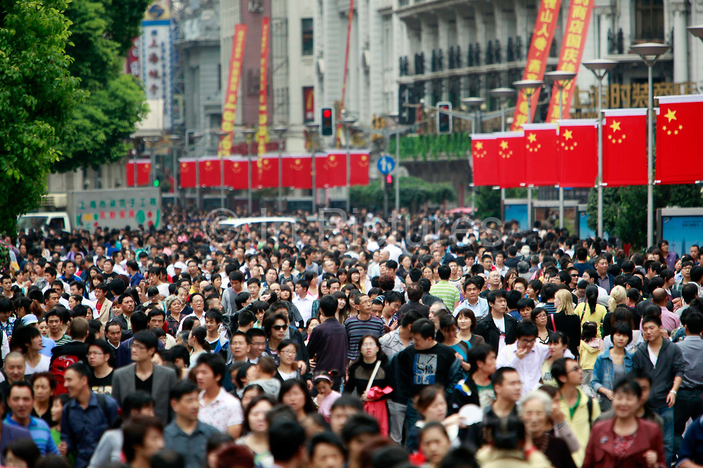 Crowds fill the Nanjing Road shopping street during the National Day break in Shanghai, China, on October 01, 2011.  China has the world's largest population, with over half of them urban residents.