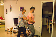 Nader (left) gives Omar a tour of their apartment in Bergen, Norway. Omar worked as a chef in Istanbul and is excited to see the kitchen.