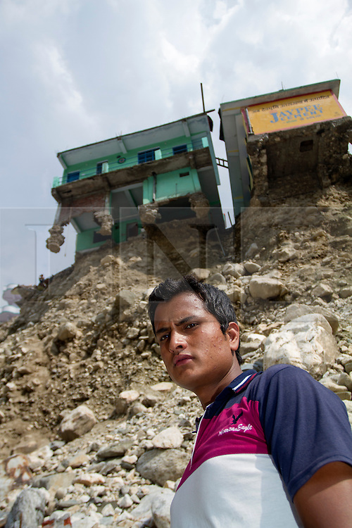 "2nd July 2013. Uttarakhand Floods.<br /> <br /> "" We knew it may happen one day; just not that day""<br /> <br /> Naveen Singh Chauhan was woken from his sleep at 2am on the night of the 16th June by heavy rain that began to fall on his village of Karadhi in Uttarkashi district. Gathering what they could they left immediately and in less than 48hrs the foundations of their house had all but completely fallen away. MANDATORY CREDIT: © Sam Spickett/RedR India, under license to London News Pictures."