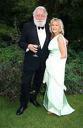 PROF.DAVID BELLAMY and LIZ BREWER at a fund raising event for The Galapagos Conservation Trust entitled 'Some Enchanted Evening' at the Chelsea Physic Garden Chelsea, London on 17th June 2004.