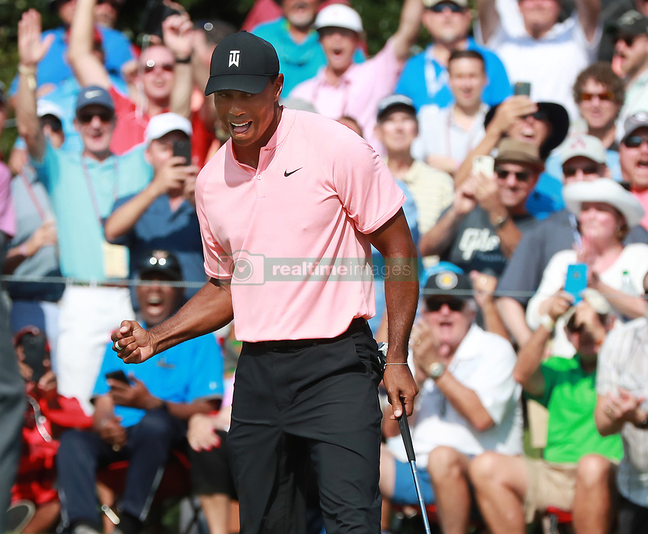 September 20, 2018 - Atlanta, Georgia, U.S. - TIGER WOODS and the gallery react as he sinks his birdie putt on the 18th green to finish 5-under par during the first round of the Tour Championship on Thursday(Credit Image: © Curtis Compton/Atlanta Journal-Constitution/TNS via ZUMA Wire)