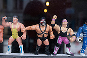 Plastic action figures of wrestling characters in the window of a bar on 5th March 2021 in London, England, United Kingdom. Some of the figures are recognisabe as from popular culture.