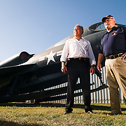 """Fred Hagen and Maj. Gen. Ronald Nelson stand in front of a rare Convair YF-2Y """"Sea Dart"""", an aircraft designed to take off and land in water. The aircraft never got out of the testing phase and is one of only four remaining. Hagen and Nelson run what they hope will one day become a world-class aircraft museum."""